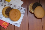 A photo of two McDonald's burgers, one 14 years old and looks new
